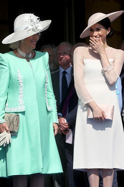Глаз не отвести: Меган Маркл и принц Гарри впервые вышли в свет после свадьбы. Фото